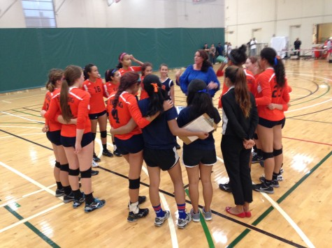The girls volleyball team huddles during their game vs Payton on Aug 28.