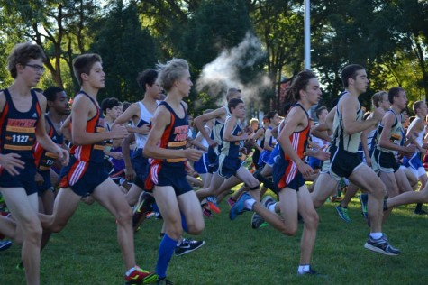Members of the boys cross country team race during a meet last season.