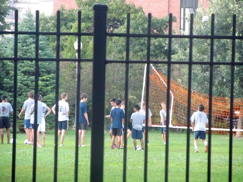 The+boys+soccer+team+practices+in+Skinner+Park.+