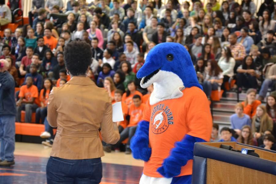 Felicia Clotworthy, pep rally emcee and Flip the Dolphin share a moment during a pep rally last year