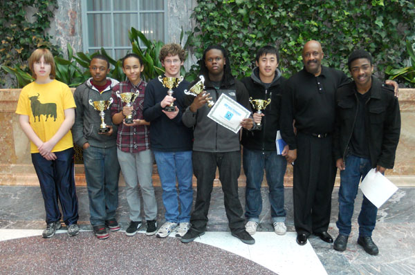 Mr. Swan with the 2013 WY Chess team. He is the second from the right, and his son, CJ, stands in the center with a trophy and a certificate.