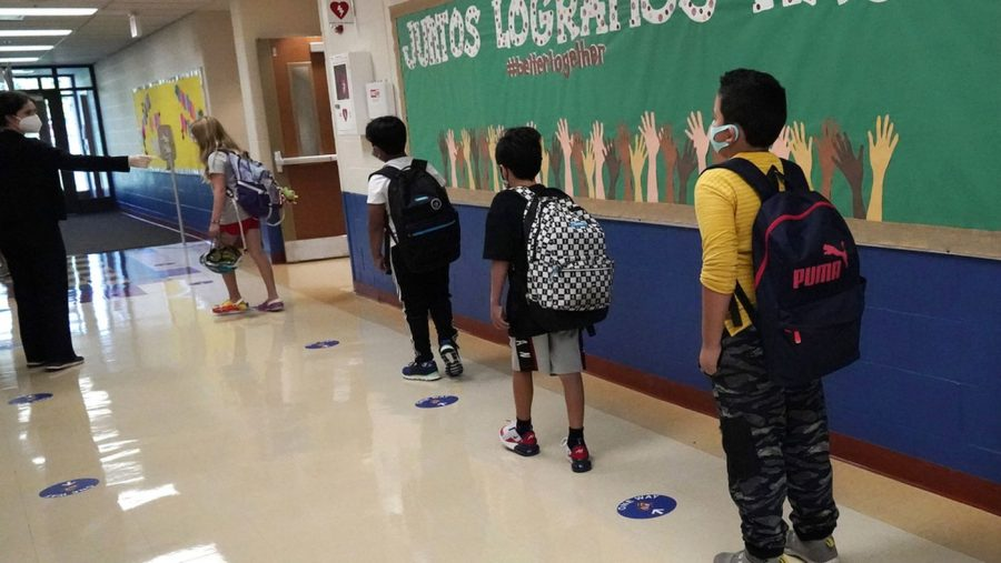Students in line waiting to enter a classroom.